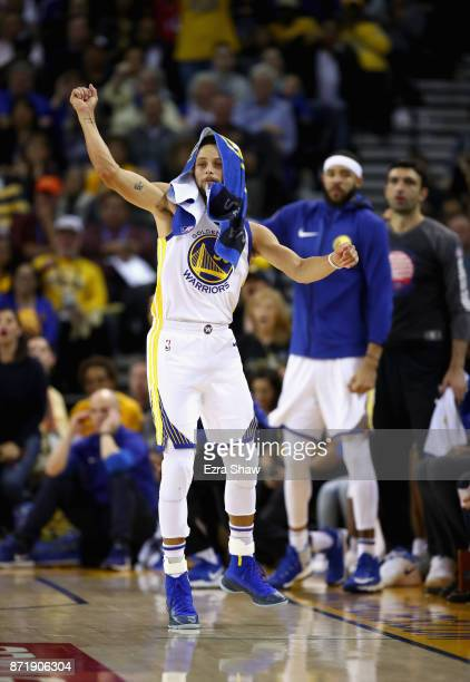 Stephen Curry of the Golden State Warriors celebrates on the bench during their game against the Minnesota Timberwolves at ORACLE Arena on November 8...