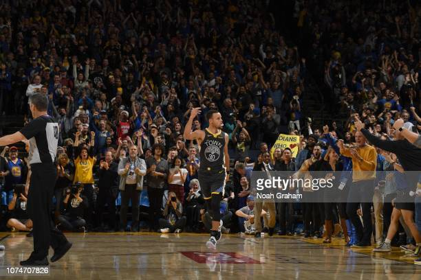 Stephen Curry of the Golden State Warriors celebrates the gamewinning shot against the LA Clippers on December 23 2018 at ORACLE Arena in Oakland...
