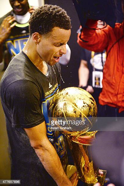 Stephen Curry of the Golden State Warriors celebrates winning the Larry O'Brein Trophy after Game Six of the 2015 NBA Finals against the Cleveland...