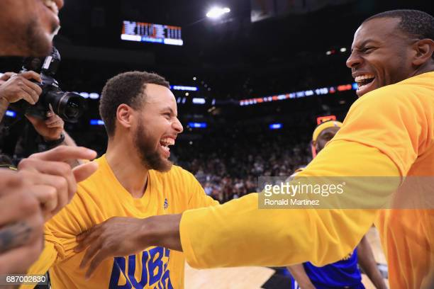 Stephen Curry of the Golden State Warriors celebrates with Andre Iguodala after defeating the San Antonio Spurs 129115 in Game Four of the 2017 NBA...