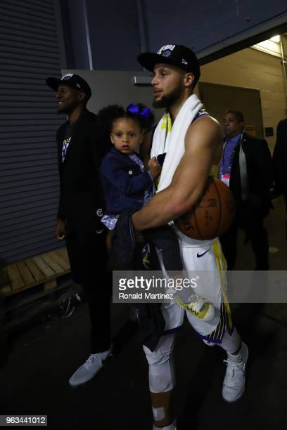 Stephen Curry of the Golden State Warriors celebrates with daughter Riley after they defeated the Houston Rockets 101 to 92 in Game Seven of the...
