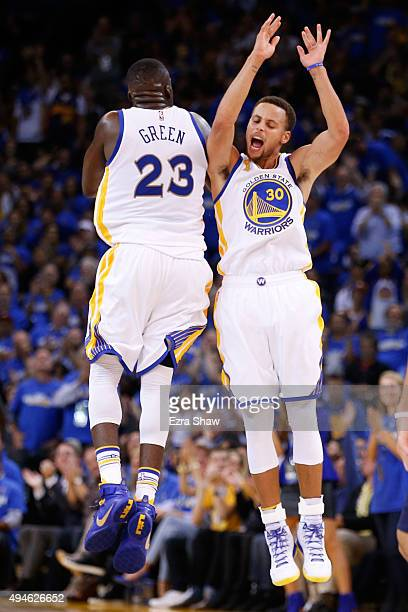 Stephen Curry of the Golden State Warriors celebrates with Draymond Green after a three point basket against the New Orleans Pelicans during the NBA...