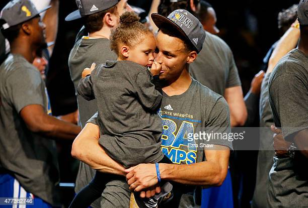 Stephen Curry of the Golden State Warriors celebrates with his daughter Riley after defeating the Cleveland Cavaliers in Game Six of the 2015 NBA...