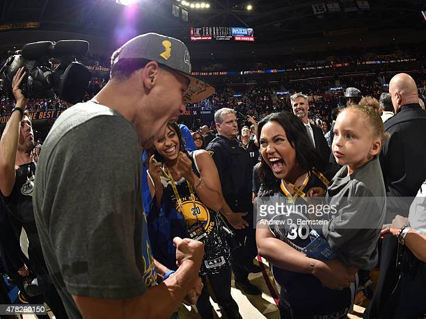 Stephen Curry of the Golden State Warriors celebrates with his wife Ayesha Curry and daughter Riley Curry after the Golden State Warriors' win...