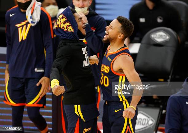 Stephen Curry of the Golden State Warriors celebrates with Jordan Poole after he made a three-point basket in the fourth quarter against the...