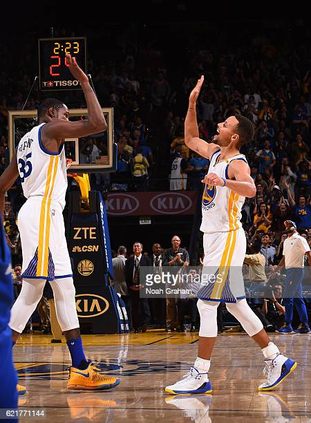 Stephen Curry of the Golden State Warriors celebrates with Kevin Durant after hitting 13 three pointers breaking the NBA record during the game...