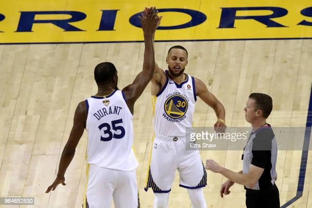 Stephen Curry of the Golden State Warriors celebrates with Kevin Durant against the Cleveland Cavaliers in Game 1 of the 2018 NBA Finals at ORACLE...
