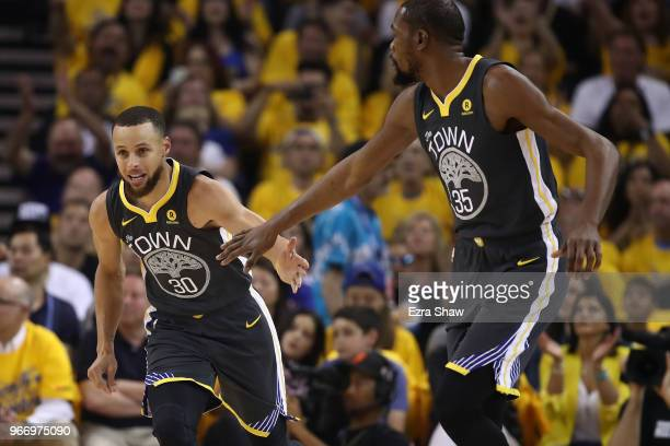 Stephen Curry of the Golden State Warriors celebrates with Kevin Durant against the Cleveland Cavaliers during the first quarter in Game 2 of the...