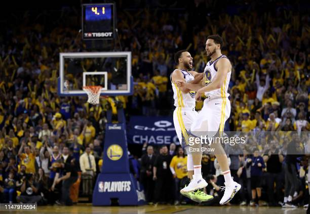 Stephen Curry of the Golden State Warriors celebrates with Klay Thompson after Thompson made the clinching basket with four second left of their game...