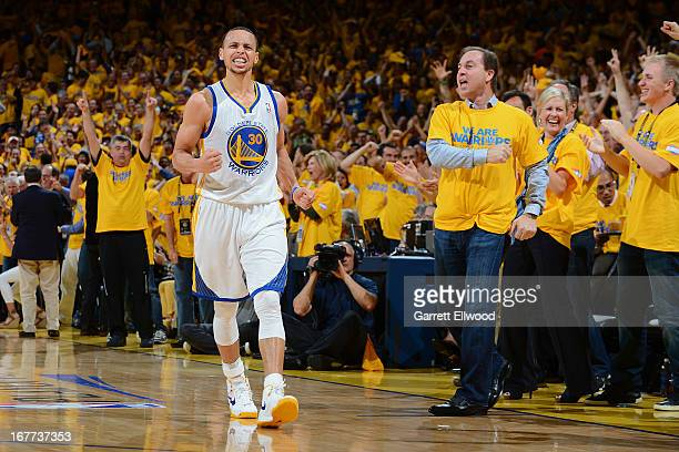 Stephen Curry of the Golden State Warriors celebrates with team majority owner Joe Lacob while playing against the Denver Nuggets in Game Four of the...