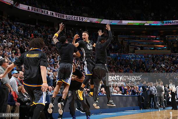 Stephen Curry of the Golden State Warriors celebrates with teammates against the Oklahoma City Thunder on February 27, 2016 at Chesapeake Energy...