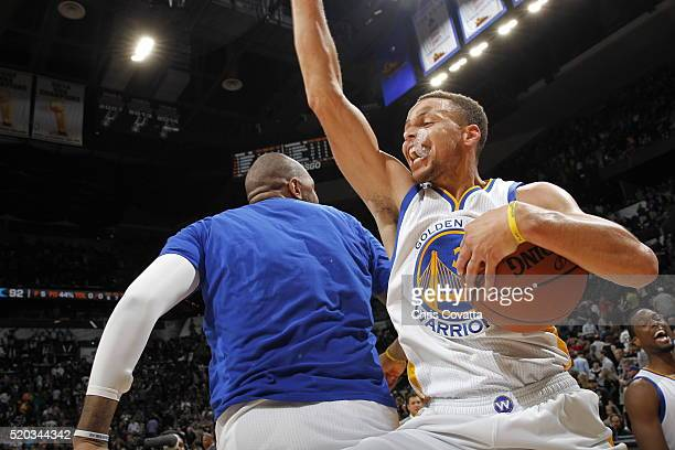 Stephen Curry of the Golden State Warriors celebrates with teammates after defeating the San Antonio Spurs on April 10 2016 at the ATT Center in San...