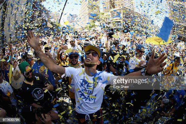 Stephen Curry of the Golden State Warriors celebrates with the crowd during the Golden State Warriors Victory Parade on June 12 2018 in Oakland...