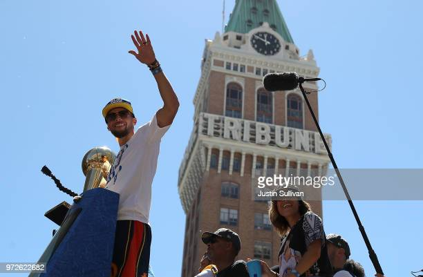 Stephen Curry of the Golden State Warriors celebrates with the championship trophy during the Golden State Warriors Victory Parade on June 12 2018 in...