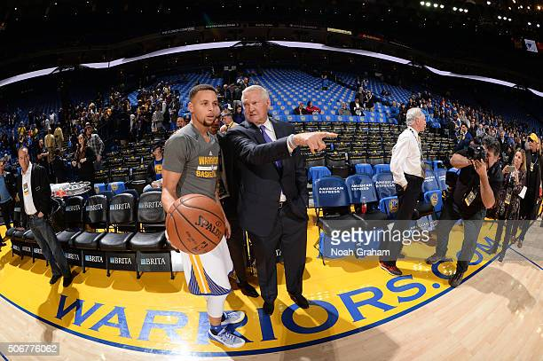 Stephen Curry of the Golden State Warriors chats with Executive board member Jerry West on January 25 2016 at Oracle Arena in Oakland California NOTE...