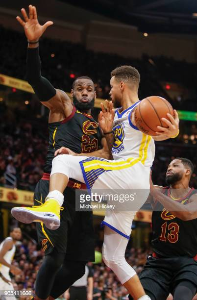 Stephen Curry of the Golden State Warriors collides with LeBron James of the Cleveland Cavaliers while driving to the basket at Quicken Loans Arena...