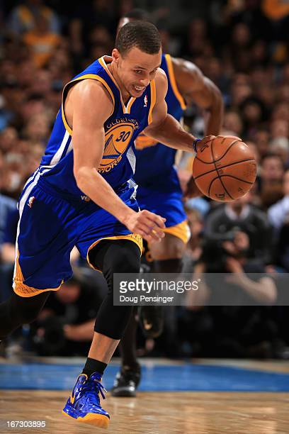 Stephen Curry of the Golden State Warriors controls the ball against the Denver Nuggets during Game Two of the Western Conference Quarterfinals of...