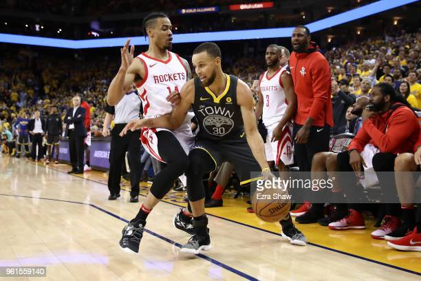 Stephen Curry of the Golden State Warriors controls the ball against Gerald Green of the Houston Rockets during Game Four of the Western Conference...