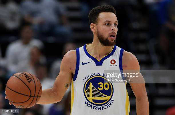 Stephen Curry of the Golden State Warriors controls the ball during a game against the Utah Jazz at Vivint Smart Home Arena on January 30 2018 in...