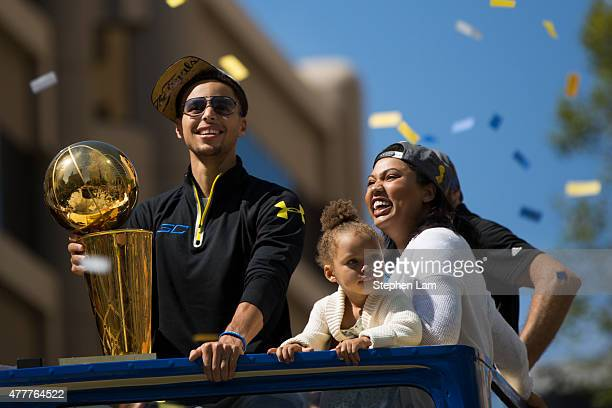 Stephen Curry of the Golden State Warriors daughter Riley and wife Ayesha smile during the Golden State Warriors Victory Parade in Oakland California...