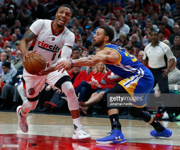 Stephen Curry of the Golden State Warriors defend Damian Lillard of the Portland Trail Blazers during Game Three of the Western Conference...