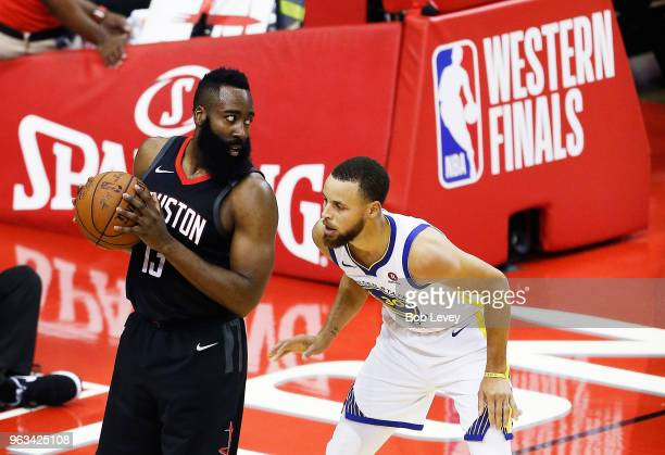 Stephen Curry of the Golden State Warriors defends against James Harden of the Houston Rockets in the first half of Game Seven of the Western...