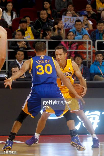 Stephen Curry of the Golden State Warriors defends against Steve Nash of the Los Angeles Lakers during the 2013 Global Games at the MasterCard Center...