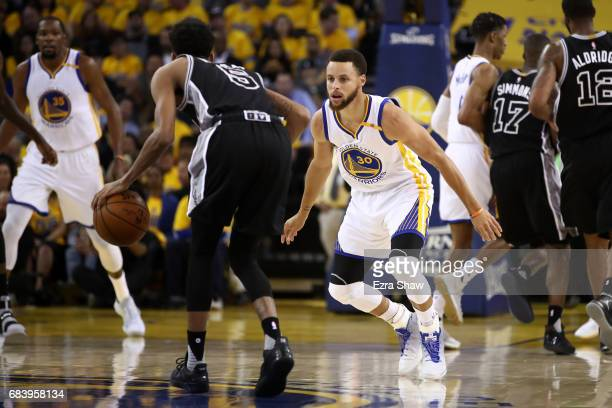 Stephen Curry of the Golden State Warriors defends Dejounte Murray of the San Antonio Spurs during Game Two of the NBA Western Conference Finals at...