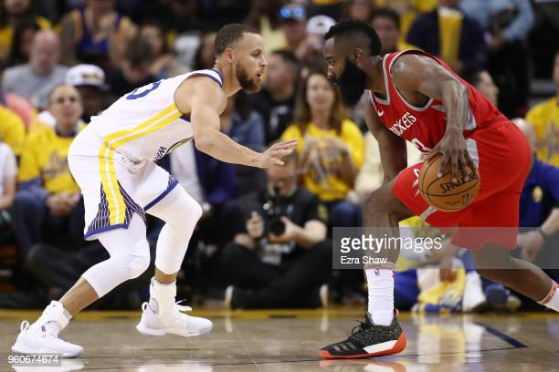 Stephen Curry of the Golden State Warriors defends James Harden of the Houston Rockets during Game Three of the Western Conference Finals of the 2018...