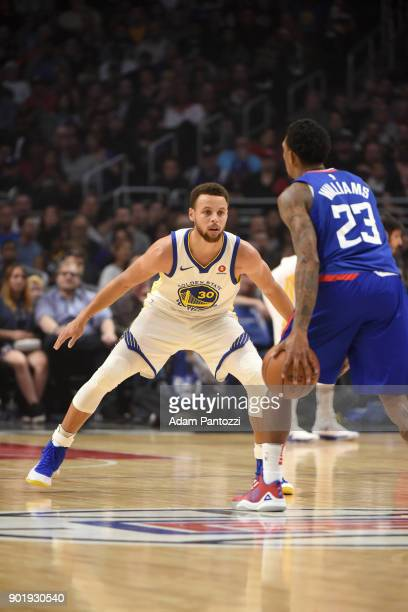 Stephen Curry of the Golden State Warriors defends Lou Williams of the LA Clippers on January 6 2018 at STAPLES Center in Los Angeles California NOTE...