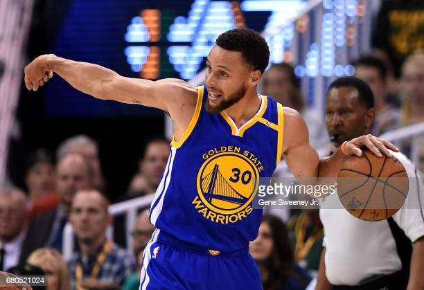 Stephen Curry of the Golden State Warriors directs a play in the first half against the Utah Jazz in Game Four of the Western Conference Semifinals...