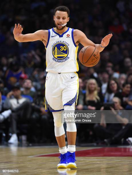 Stephen Curry of the Golden State Warriors directs the offense in the third quarter of the game against the Los Angeles Clippers on January 6 2018 in...