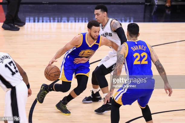 Stephen Curry of the Golden State Warriors dribbles against Danny Green of the San Antonio Spurs in the first half during Game Three of the 2017 NBA...