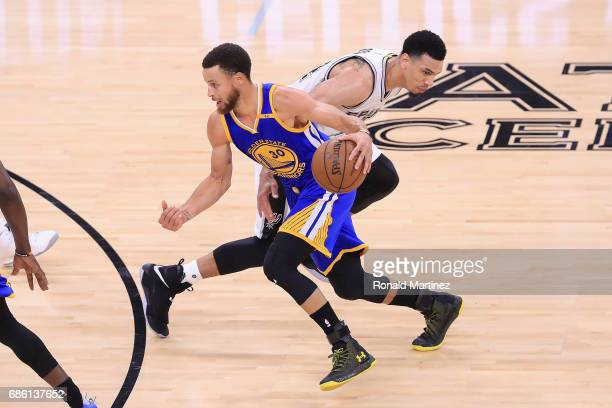 Stephen Curry of the Golden State Warriors dribbles against Danny Green of the San Antonio Spurs in the second half during Game Three of the 2017 NBA...