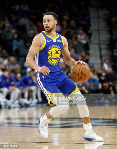 Stephen Curry of the Golden State Warriors dribbles during game against the San Antonio Spurs at ATT Center on March 18 2019 in San Antonio Texas...