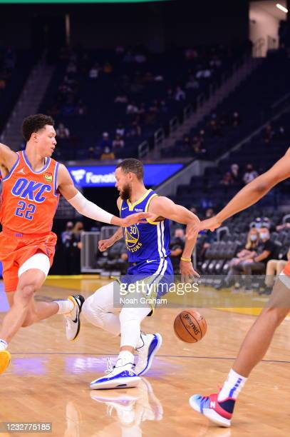 Stephen Curry of the Golden State Warriors dribbles during the game against the Oklahoma City Thunder on April 8, 2021 at Chase Center in San...