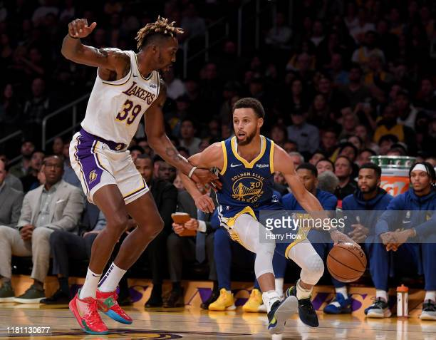 Stephen Curry of the Golden State Warriors dribbles in front of Dwight Howard of the Los Angeles Lakers during the first half at Staples Center on...