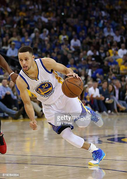 Stephen Curry of the Golden State Warriors dribbles the ball against the Portland Trail Blazers at ORACLE Arena on April 3 2016 in Oakland California...