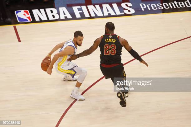 Stephen Curry of the Golden State Warriors dribbles the ball around LeBron James of the Cleveland Cavaliers in Game Four of the 2018 NBA Finals on...