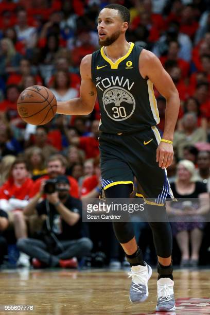 Stephen Curry of the Golden State Warriors dribbles the ball down court against the New Orleans Pelicans during Game Three of the Western Conference...