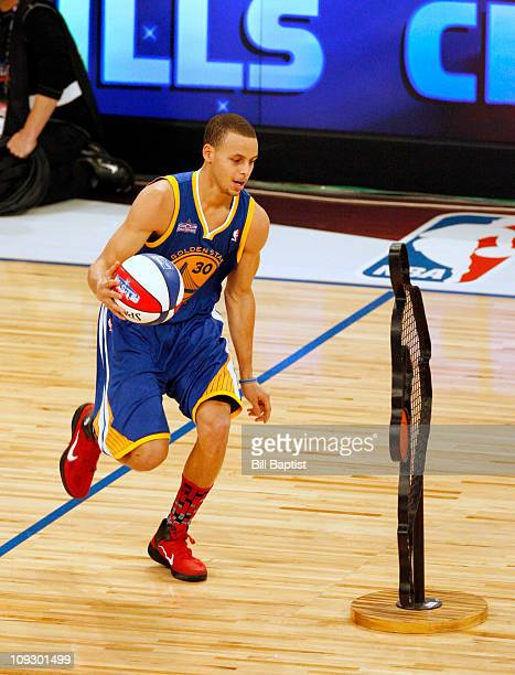 Stephen Curry of the Golden State Warriors dribbles the ball during The Taco Bell Skills Challenge during 2011 AllStar Saturday Night presented by...