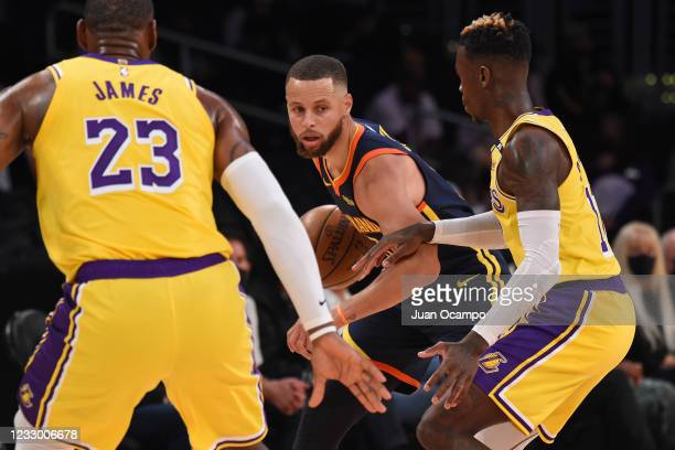 Stephen Curry of the Golden State Warriors dribbles the ball during the game against the Los Angeles Lakers during the 2021 NBA Play-In Tournament on...