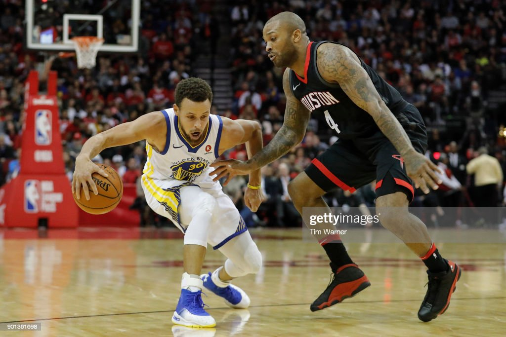 Stephen Curry #30 of the Golden State Warriors dribbles the ball in the second half defended by PJ Tucker #4 of the Houston Rockets at Toyota Center on January 4, 2018 in Houston, Texas.