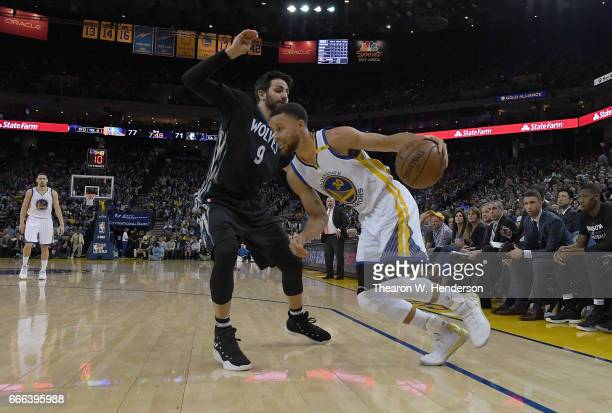 Stephen Curry of the Golden State Warriors dribbles the ball on offense while guarded by Ricky Rubio of the Minnesota Timberwolves during an NBA...