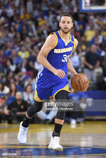 Stephen Curry of the Golden State Warriors dribbles the ball on offense against the Washington Wizards during an NBA Basketball game at ORACLE Arena...