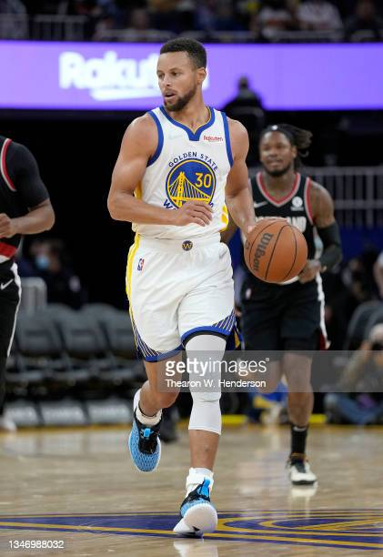 Stephen Curry of the Golden State Warriors dribbles the ball up court against the Portland Trail Blazers during the second half of their game at...