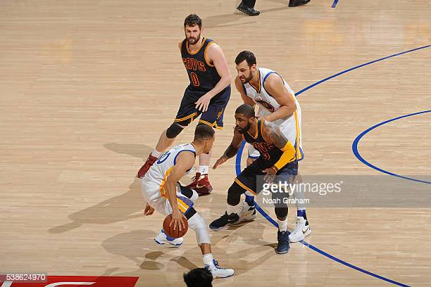 Stephen Curry of the Golden State Warriors dribbles the ball while defended by Kyrie Irving of the Cleveland Cavaliers during Game Two of the 2016...