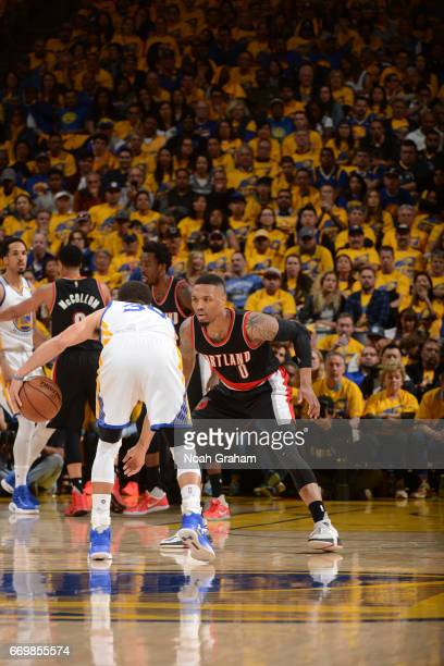 Stephen Curry of the Golden State Warriors dribbles the ball while guarded by Damian Lillard of the Portland Trail Blazers during the Western...