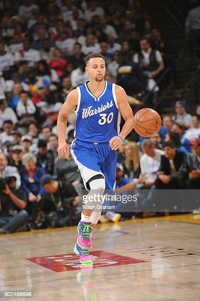 Stephen Curry of the Golden State Warriors dribbles up court against the Cleveland Cavaliers on December 25 2015 at ORACLE Arena in...