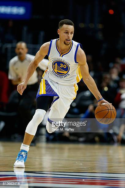 Stephen Curry of the Golden State Warriors dribbles upcourt during the first half of a game against the Los Angeles Clippers at Staples Center on...